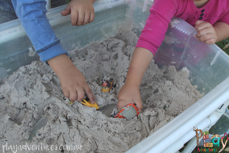 Two children playing with sand foam