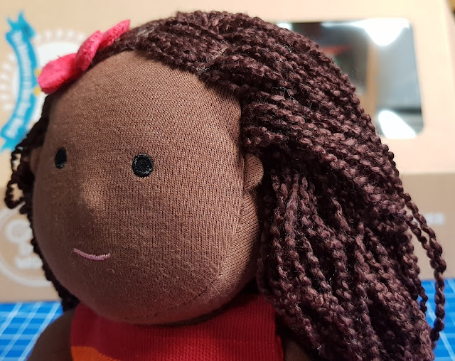 One Dear World Hearty Hope doll with poppy in hair