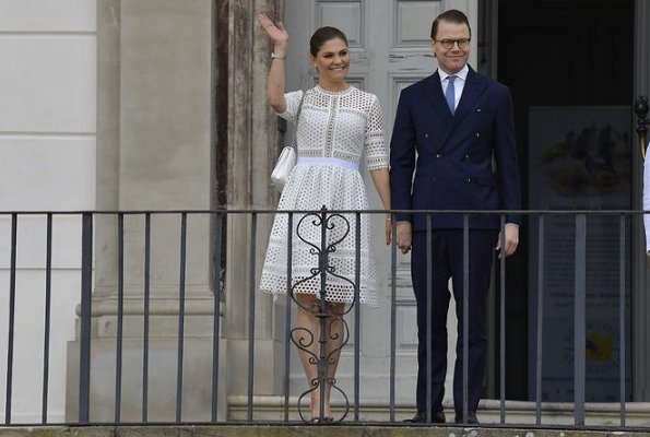 Crown-Princess Victoria wore By Malina Emily Midi Dress, Gianvito Rossi pumps and she carried Ralph Lauren Ricky chain bag, Sweden's National Day 2018