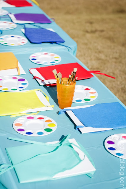 Smocks and paint trays for an art party or a rainbow party