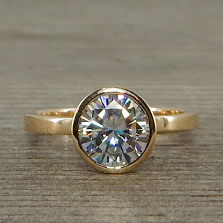 moissanite gold solitaire ring