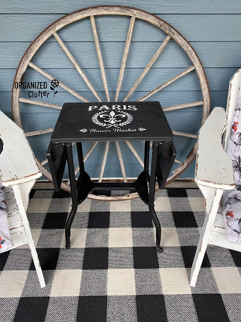 Photo of a painted & stenciled vintage typing table on the covered patio