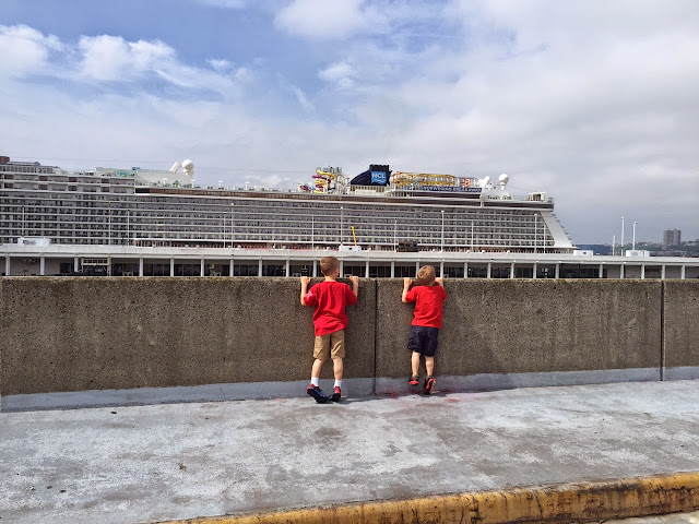 boys looking at ncl cruise ship