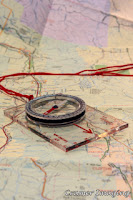 Cramer Imaging's professional quality stock photograph of a map and direction-finding compass laid out on top