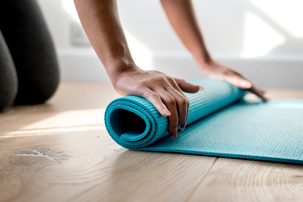 Yoga mat being rolled out