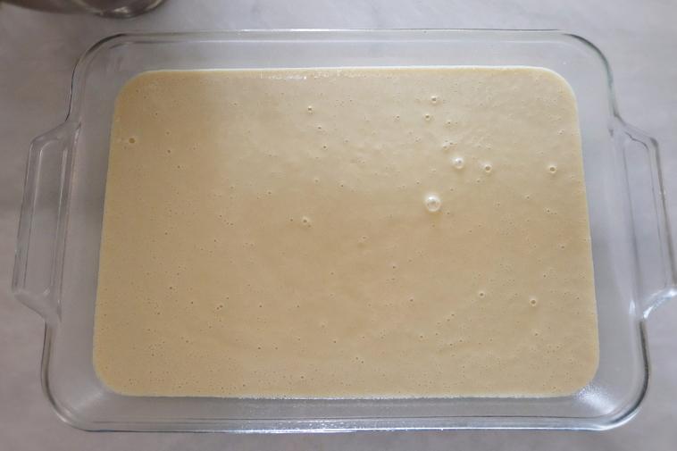 hot milk batter in baking pan