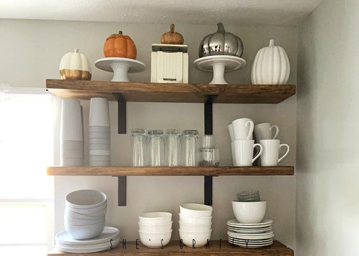 Halloween home decor in the kitchen - pumpkins on open shelves