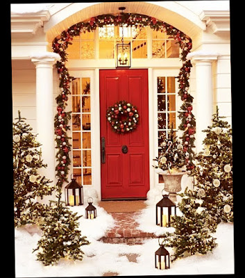 Beautiful Winter Nuance Entrance Traditional Christmas Front Door Decorations With Snow and Lovely Christmas Trees and Lantern With Red Door and Glass Windows Beside Photo