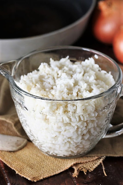 Measuring Cup of Cooked Rice Image