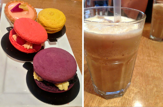 Glass of coffee and mixed macrons
