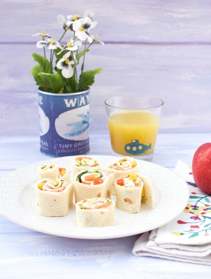 Vegetable pinwheel sandwiches on a cream plate