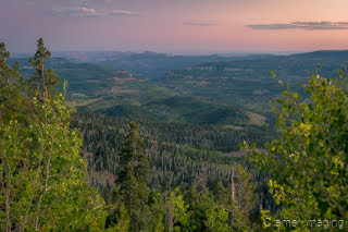 Cramer Imaging's fine art landscape photograph of an evening view down into a forested valley at sunset