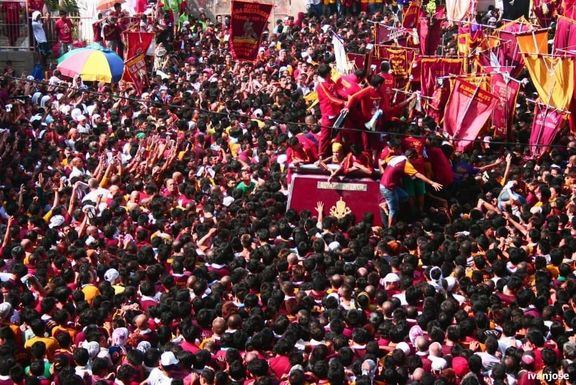 Devotees trying to touch the image of the Black Nazarene during the Holy Week procession
