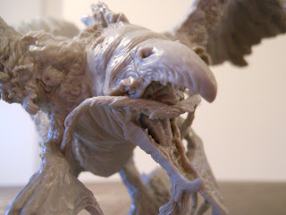 Close up details of the phoenix from Kingdom Death: Monster