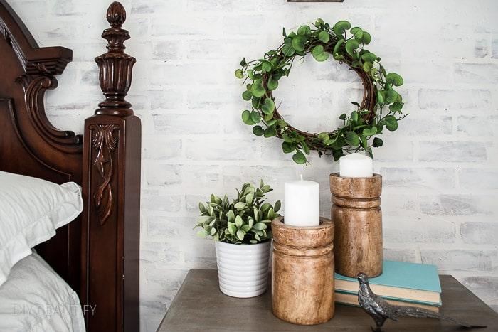 wreath hanging on brick wall