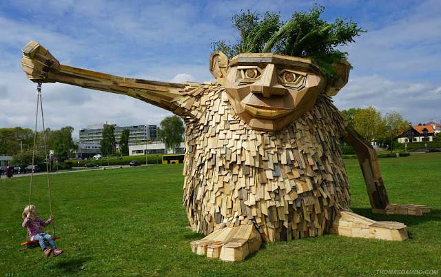 Giant Troels The Troll sculpture with swing