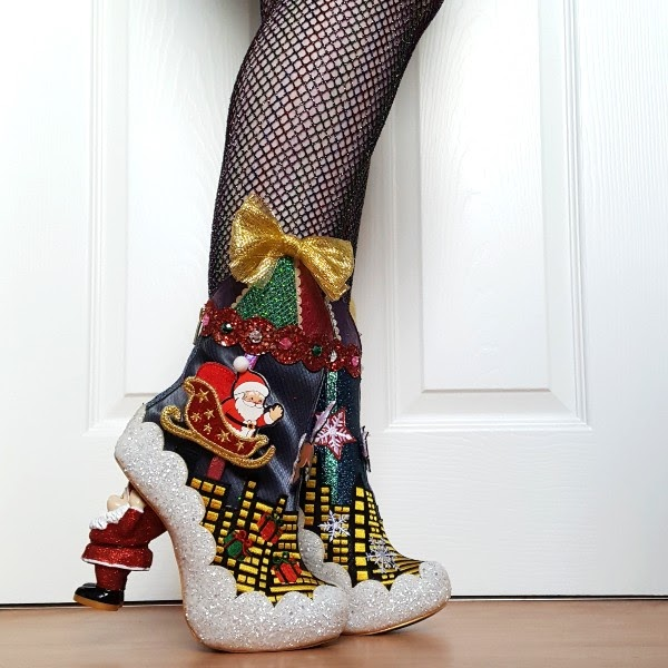 wearing irregular choice Christmas ankle boots with Santa sleigh skyline