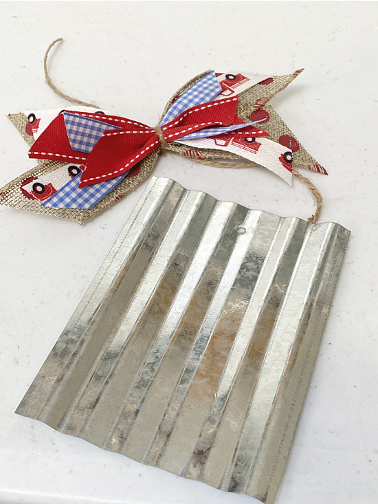 galvanized steel and red, white and blue bow