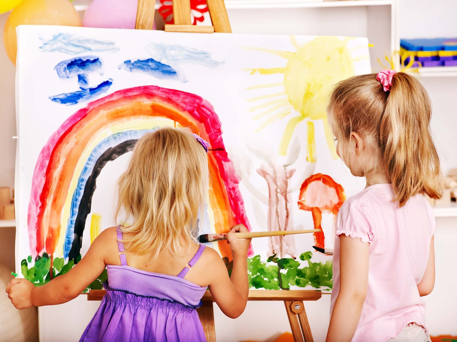 Little girl painting - childcare vouchers - motherdistracted.co.uk
