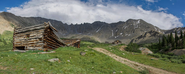 Old mining cabins in Mayflower Gulch with Atlantic Peak and Fletcher Mountain