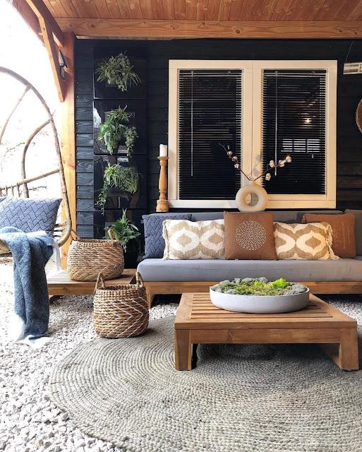 bohemian patio area with white modern donut vase