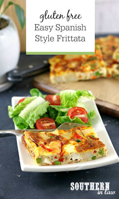 Easy Spanish Style Frittata Recipe - Gluten Free Potato Peas and Red Capsicum Frittata on White Rectangle Plate with Salad of Cherry Tomatoes and Cos Lettuce