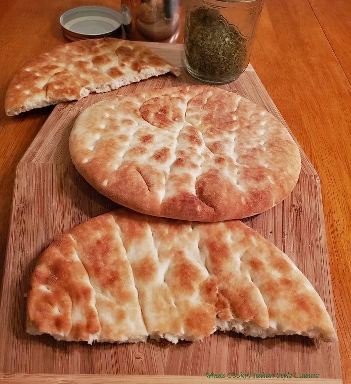 this is pita bread on a wooden board