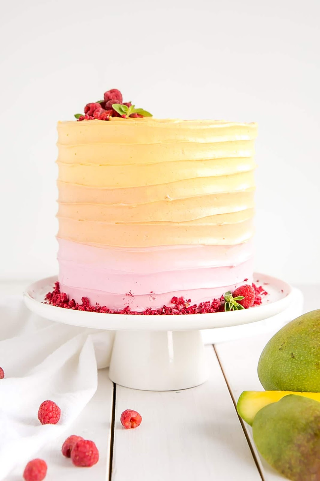 Raspberry Mango Cake - This Raspberry Mango Cake is the perfect way to celebrate the summer months. Raspberry cake layers and a heavenly mango frosting.