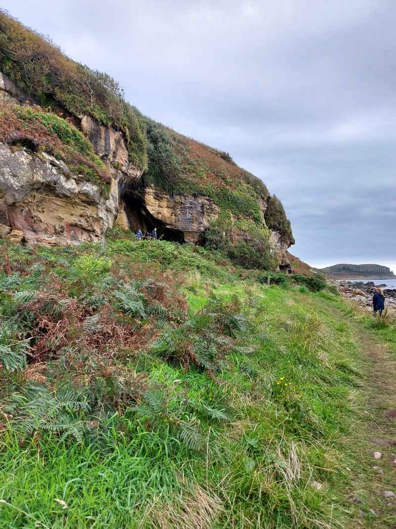 Looking up towards the caves from the shore on the Kings Cave walk