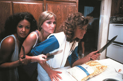 Movie scene in the horror film The Slumber Party Massacre where three girls wield knives and try to fend off an attacker