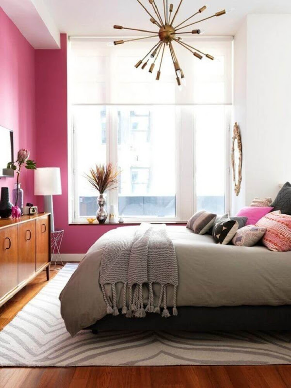 Decoration of feminine room with pink wall and different lamp