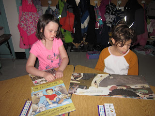 Kindergartner reading with a third grader.