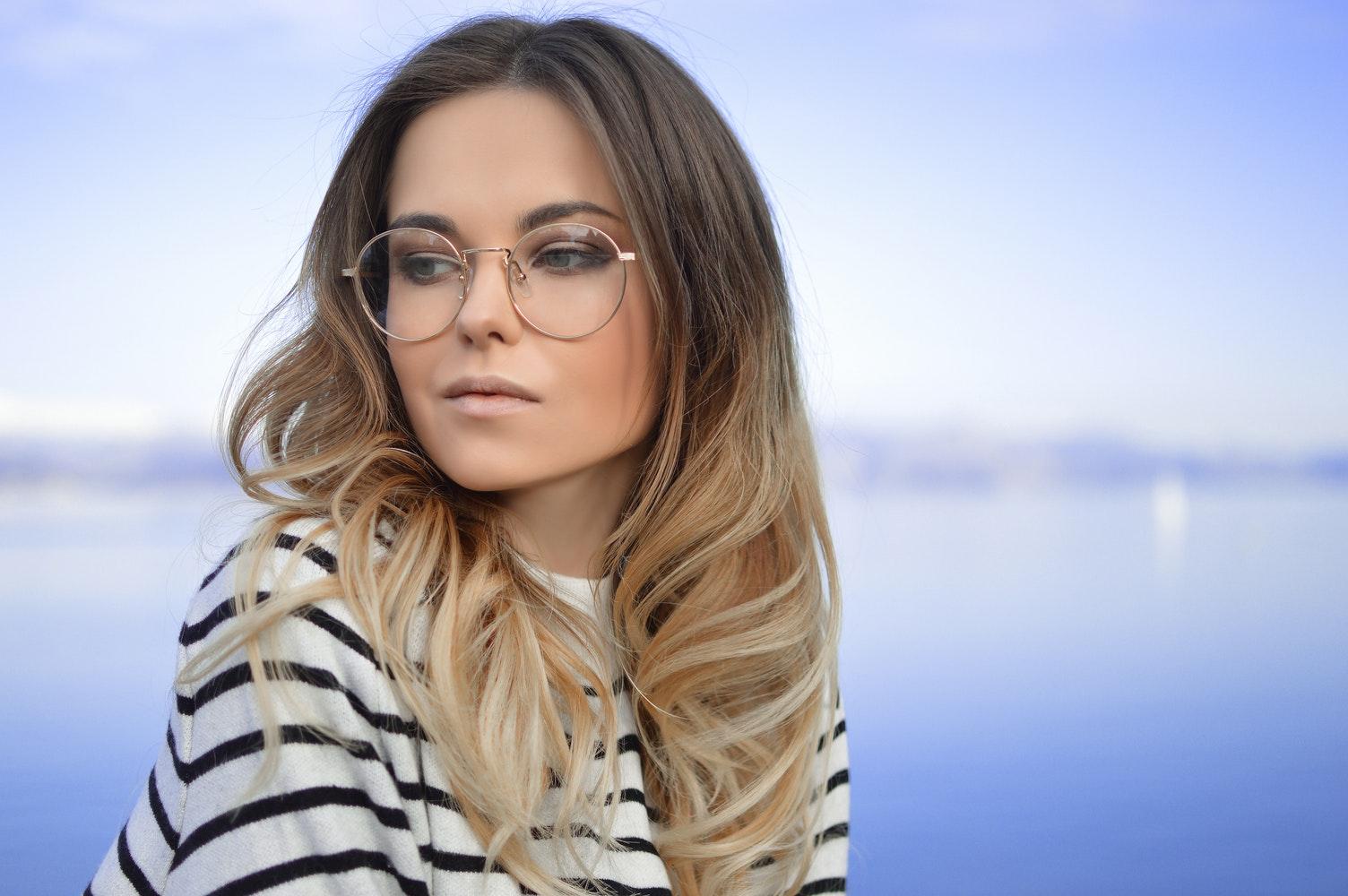 portrait of blond girl in nerd glasses