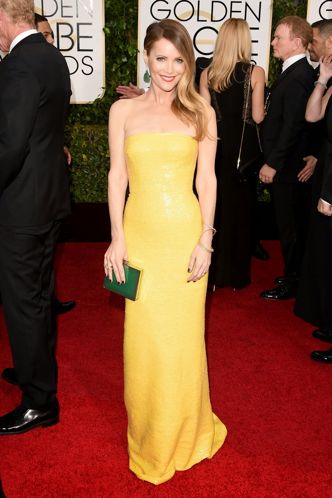 Leslie Mann in yellow gown at the Golden Globe Awards 2015