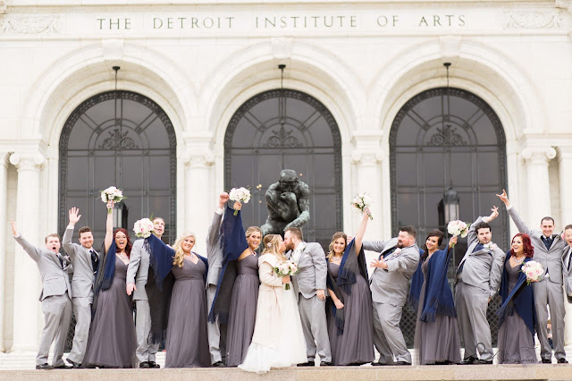 bridal party at Detroit Institute of Arts kissing