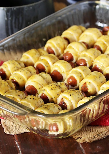 Pan of Pigs In a Blanket with Brown Sugar Poppy Seed Glaze Image
