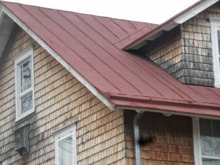 Roof sealer in traditional red that is ten years old in Whitesbog Villatge, NJ