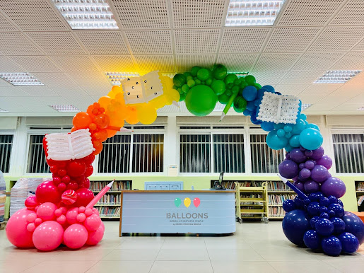 Organic Balloon Arch with 'Books and Coloured Pencil' accent details!