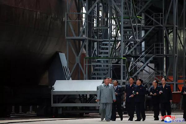 (3) Kim Jong Un inspects newly built submarine, July 2019