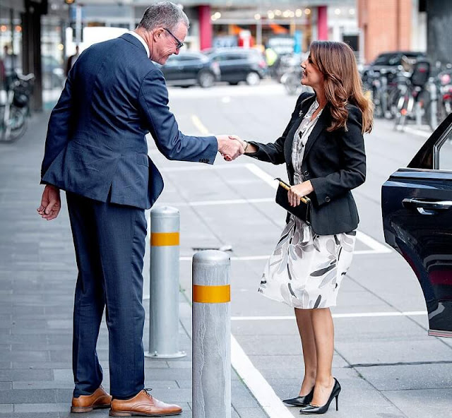 Princess Marie wore a floral print bib-front dress by Peserico. The Princess wore a blazer by Armani
