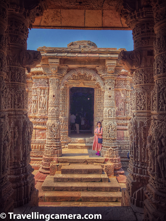 Symmetry across Modhera Sun Temple is very tempting and that's why you see so many photographs in this Photo Journey showing series of pillars or carvings leading to one another. In above photograph, Vibha is not really posing but waiting for me to move on and go to other side of the temple. That's a typical scene when I get so busy with my travellingcamera.