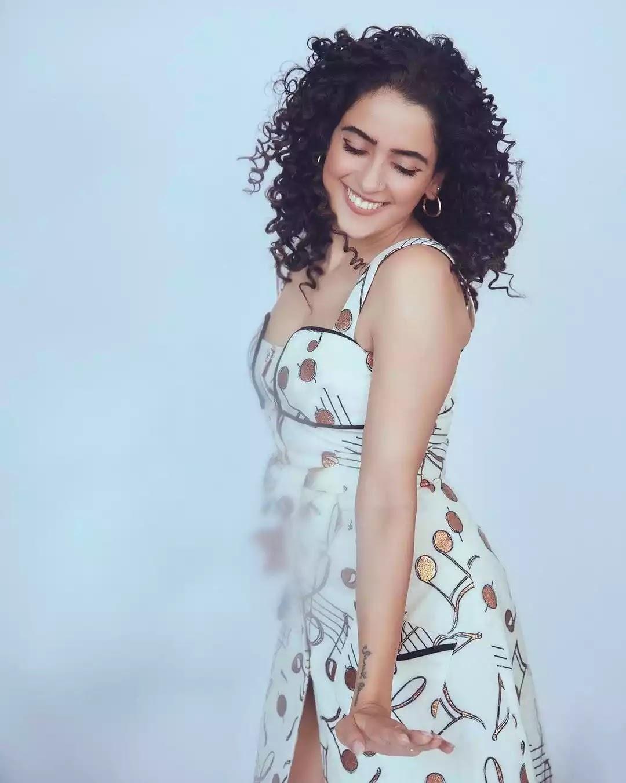 sanya-malhotra-hot-looks-in-white-printed-sleeveless-mini-dress