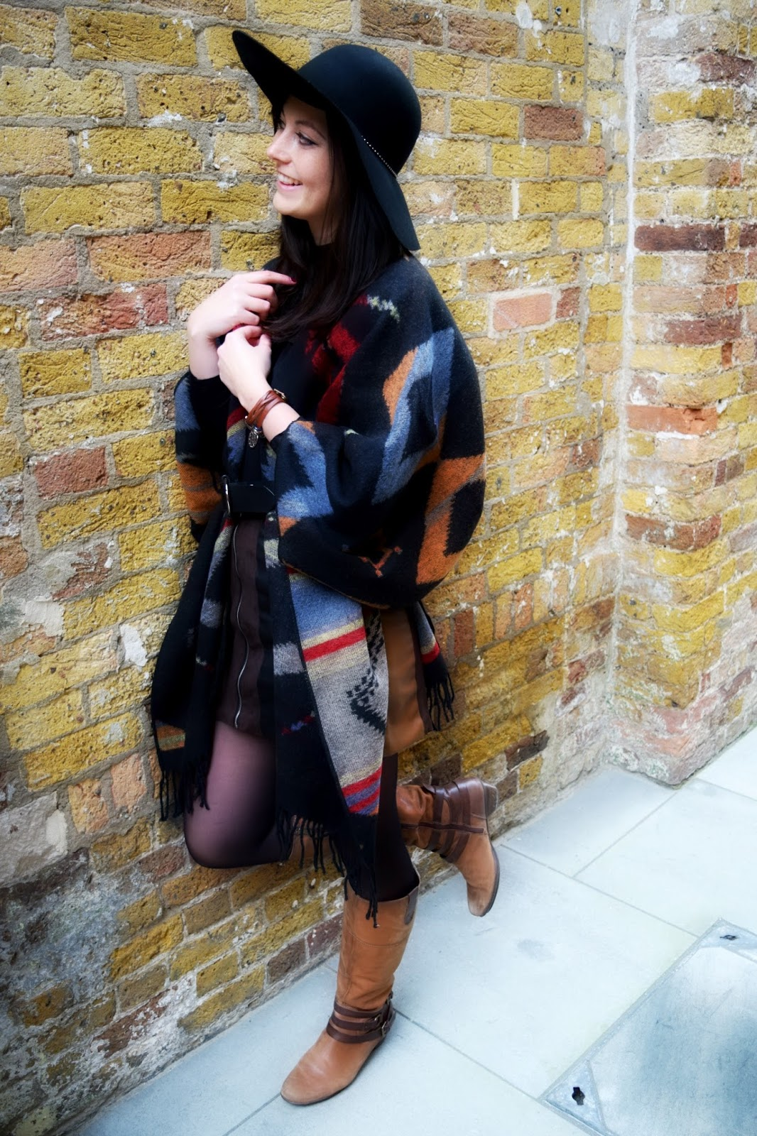 outfit fashion post showcasing a two sided poncho