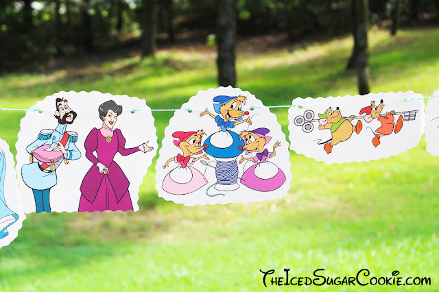 DIY Cinderella Birthday Party Banner Ideas- Disney Characters Prince Charming, Stepmother Lady Tremaine, Drizella, Anastasia, The Grand Duke, Gus, Jaq, Mary, Suzy, Perla, Lucifer Cat by The Iced Sugar Cookie