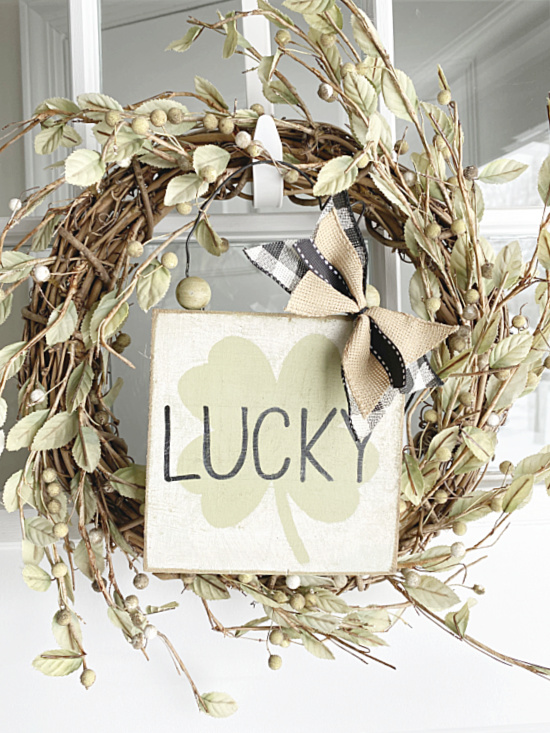 lucky sign hanging on a wreath