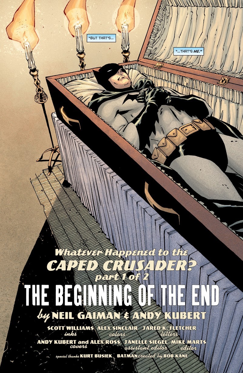 Batman, apparently dead, lying in an open coffin with his arms crossed over his chest and cape swaddled around his feet