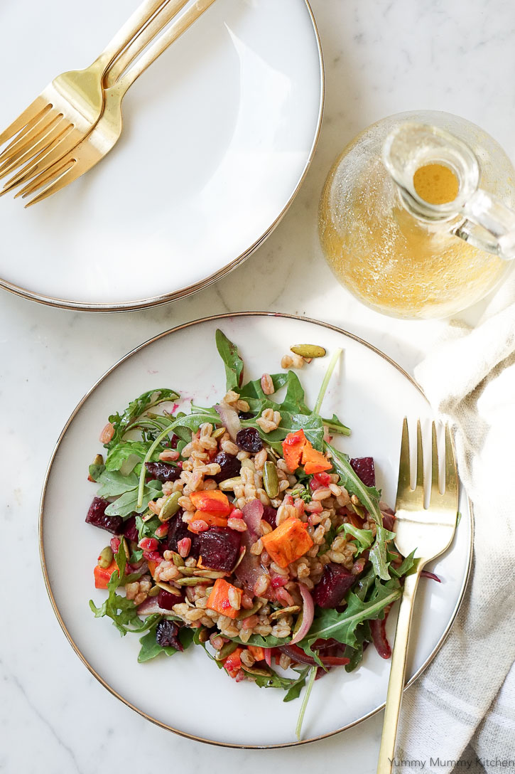 Apple cider vinaigrette with a salad of arugula, beets, sweet potato, and farro.