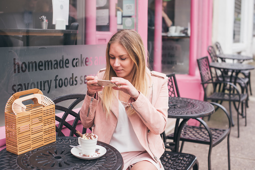 Rachel Emily dressed in Pink Instagramming a beautiful hot chocolate