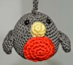http://media.blacksheepwools.com/media/wysiwyg/crochet_christmas_robin.pdf