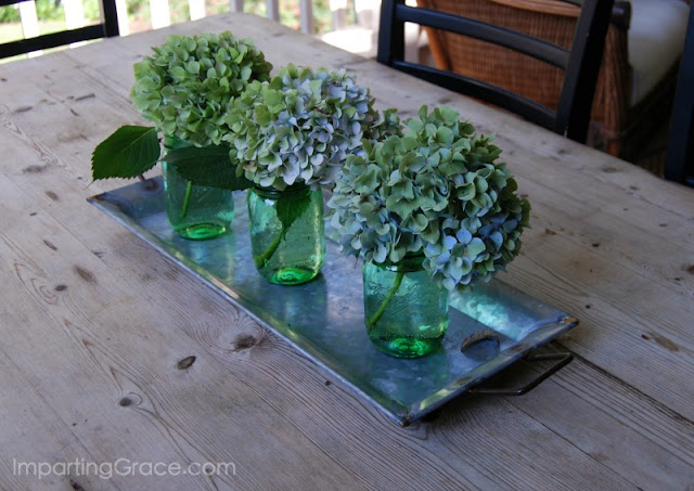 Centerpiece for dining table composed of galvanized tray holding Mason jars and flowers Simple and lovely!